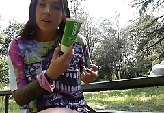 felicity feline fucks her asshole and pussy outside on a bench