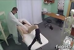 Seductive and bewitching doctor undresses to get fucked