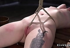 Tied up slave hard whipped to red skin