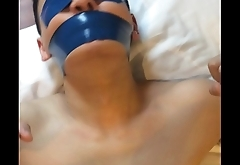 Chinese slave boy Tied up and tightly tape gagged with blue PVC tape
