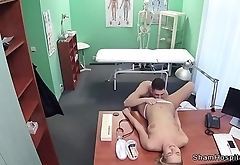 Muscular young guy fucks blonde nurse