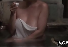 Lovely mature gets on her knees and gives awesome blowjob